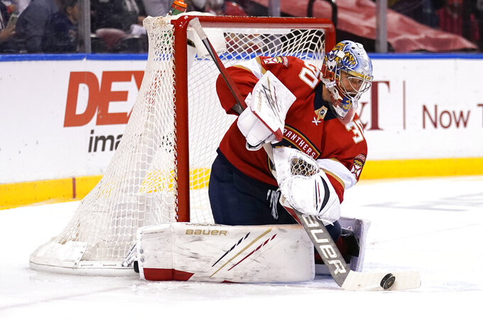 FILE - In this Monday, May 24, 2021, file photo, Florida Panthers goaltender Spencer Knight (30) stops a shot on the goal during the first period in Game 5 of an NHL hockey Stanley Cup first-round playoff series against the Tampa Bay Lightning, in Sunrise, Fla. Knight was a rising star for the Panthers last season and is preparing for his first full season at the NHL level. (AP Photo/Lynne Sladky, File)