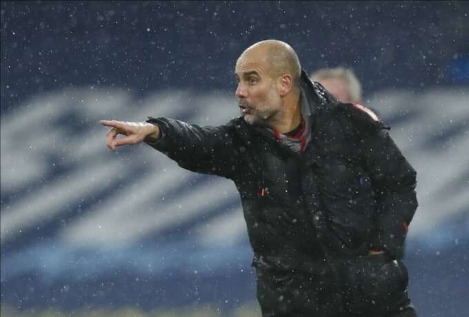 Manchester City's head coach Pep Guardiola gives instructions during the English Premier League soccer match between Manchester City and Newcastle United at the Etihad Stadium in Manchester, England, Saturday, Dec., 26, 2020. (Clive Brunskill/ Pool via AP)