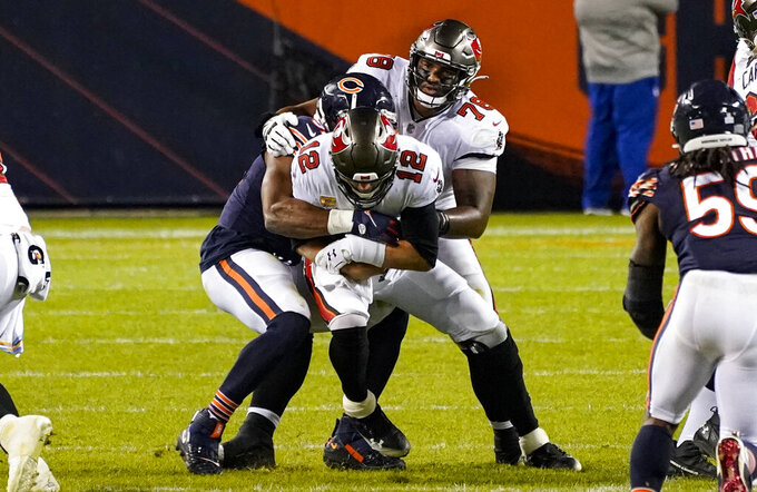 Tampa Bay Buccaneers quarterback Tom Brady (12) is sacked by Chicago Bears outside linebacker Khalil Mack (52) during the second half of an NFL football game in Chicago, Thursday, Oct. 8, 2020. (AP Photo/Nam Y. Huh)