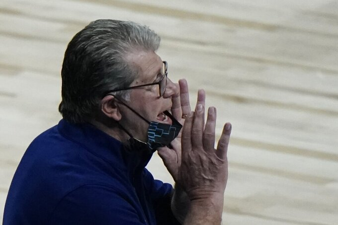 UConn head coach Geno Auriemma yells to his players during the second half of an NCAA college basketball game against Iowa in the Sweet 16 round of the Women's NCAA tournament Saturday, March 27, 2021, at the Alamodome in San Antonio. (AP Photo/Morry Gash)