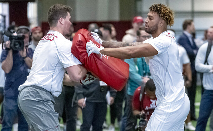 Alabama's Hale Hentges and Alabama's Irv Smith Jr. spar in drills at the Alabama NFL football Pro Day, Tuesday, March 19, 2019, in Tuscaloosa, Ala. (AP Photo/Vasha Hunt)