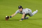 Houston Astros center fielder Jake Meyers makes a diving attempt on a single hit by Texas Rangers' Isiah Kiner-Falefa in the third inning of a baseball game in Arlington, Texas, Monday, Sept. 13, 2021. (AP Photo/Tony Gutierrez)