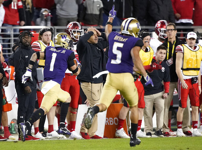 Washington defensive back Myles Bryant (5) celebrates as defensive back Byron Murphy (1) returns an interception for a touchdown against Utah during the second half of the Pac-12 Conference championship NCAA college football game in Santa Clara, Calif., Friday, Nov. 30, 2018. (AP Photo/Tony Avelar)