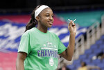 Notre Dame's Jackie Young (5) holds a piece of the net after her team defeated Louisville in an NCAA college basketball game in the championship of the Atlantic Coast Conference women's tournament in Greensboro, N.C., Sunday, March 10, 2019. Young was named the tournament's MVP. (AP Photo/Chuck Burton)