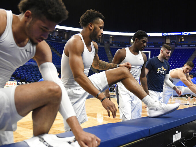 From left to right, Penn State players Seth Lundy, Lamar Stevens, Mike Watkins, Trent Buttrick and John Harrar stretch before an NCAA college basketball game against Central Connecticut State, Friday, Dec. 20, 2019, in State College, Pa. (AP Photo/John Beale)