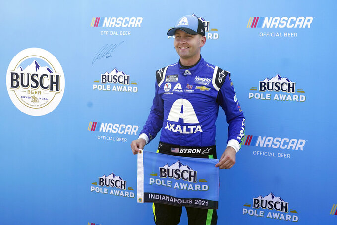 William Byron poses after winning the pole for the NASCAR Series auto race at Indianapolis Motor Speedway, Sunday, Aug. 15, 2021, in Indianapolis. (AP Photo/Darron Cummings)