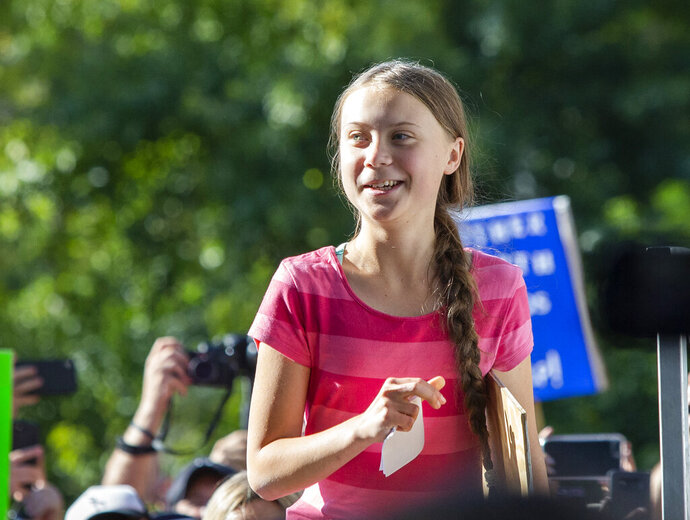 Swedish teenage climate activist Greta Thunberg arrives to the podium to speak as she takes part during the Climate Strike, Friday, Sept. 20, 2019 in New York. Tens of thousands of protesters joined rallies on Friday as a day of worldwide demonstrations calling for action against climate change began ahead of a U.N. summit in New York. (AP Photo/Eduardo Munoz Alvarez)
