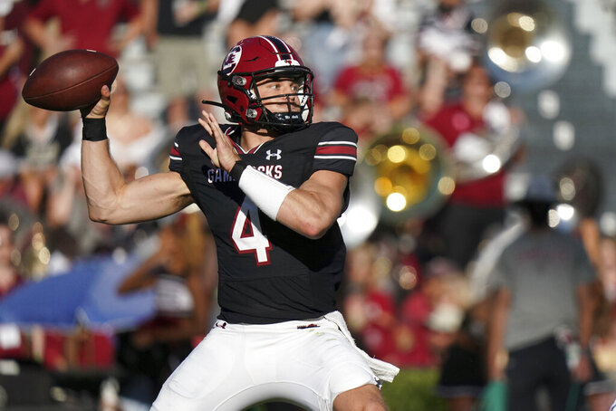 South Carolina quarterback Luke Doty (4) throws a pass during the first half of an NCAA college football game against Vanderbilt, Saturday, Oct. 16, 2021, in Columbia, S.C. (AP Photo/Sean Rayford)