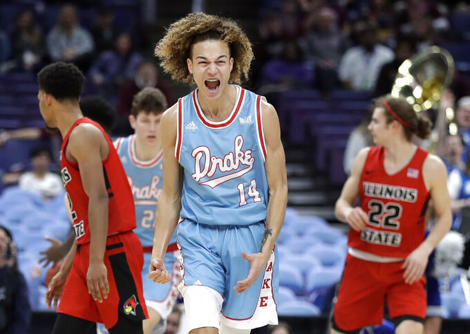 Drake's Noah Thomas (14) celebrates during the second half of an NCAA college basketball game against Illinois State in the quarterfinal round of the Missouri Valley Conference tournament, Friday, March 8, 2019, in St. Louis. (AP Photo/Jeff Roberson)