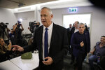 Blue and White party leader Benny Gantz arrives to give a statement for media in Tel Aviv, Thursday, Sept. 19, 2019. Benny Gantz's Blue and White has pledged not to sit in the same government as Netanyahu, as the long-serving Israeli leader is expected to face indictment in a slew of corruption scandals. (AP Photo/Sebastian Scheiner)