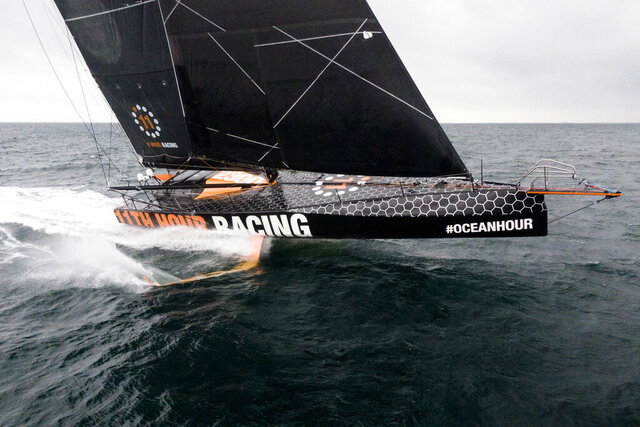 This July 25, 2020 photo provided by 11th Hour Racing shows the 11th Hour Racing Team during training off the coast of Concarneau, France, after a long winter of modifications. The team will sail the boat across the Atlantic to Rhode Island starting Saturday, Aug. 1, 2020, as it shifts its training base for the next Ocean Race, which has been delayed a year to 2022 due to COVID-19. (Amory Ross/11th Hour Racing via AP)