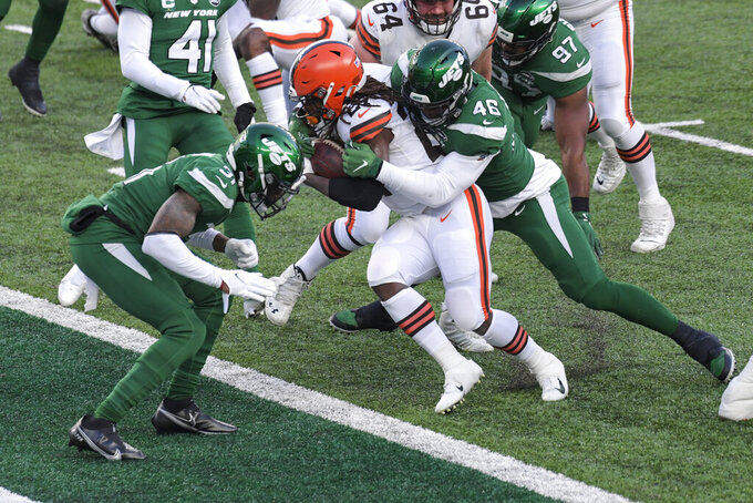 Cleveland Browns' Kareem Hunt (27) rushes for a touchdown as New York Jets' Neville Hewitt (46) tackles him at the goal line during the second half of an NFL football game Sunday, Dec. 27, 2020, in East Rutherford, N.J. (AP Photo/Bill Kostroun)