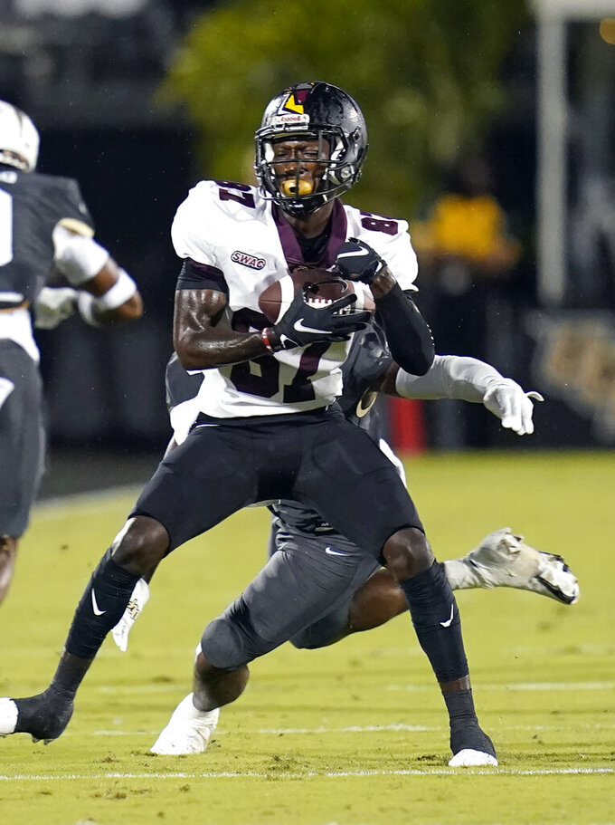 Bethune-Cookman wide receiver Daveno Ellington makes a reception in front of Central Florida defensive back Dyllon Lester during the first half of an NCAA college football game Saturday, Sept. 11, 2021, in Orlando, Fla. (AP Photo/John Raoux)