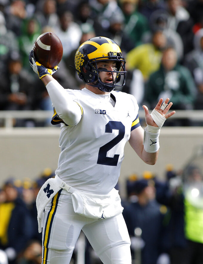 Michigan quarterback Shea Patterson throws a pass against Michigan State during the first quarter of an NCAA college football game, Saturday, Oct. 20, 2018, in East Lansing, Mich. (AP Photo/Al Goldis)