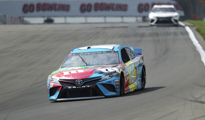 Kyle Busch heads into Turn 1 during a practice run for a NASCAR Cup Series auto race at Watkins Glen International, Saturday, Aug. 3, 2019, in Watkins Glen, N.Y. (AP Photo/John Munson)