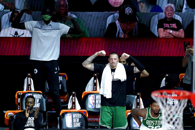 The Boston Celtics bench reacts after Robert Williams III dropped a dunk on the Toronto Raptors during the second half of an NBA basketball game Friday, Aug. 7, 2020 in Lake Buena Vista, Fla. (AP Photo/Ashley Landis, Pool)