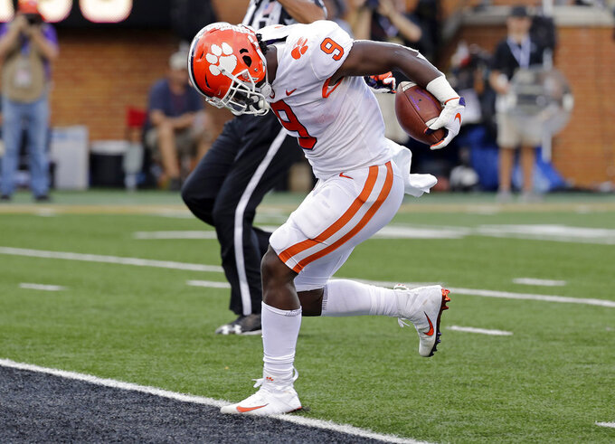 Clemson's Travis Etienne (9) runs for a touchdown against Wake Forest during the first half of an NCAA college football game in Charlotte, N.C., Saturday, Oct. 6, 2018. (AP Photo/Chuck Burton)