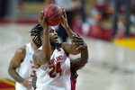 Maryland forward Donta Scott drives to the basket against Rutgers center Cliff Omoruyi during the first half of an NCAA college basketball game, Monday, Dec. 14, 2020, in College Park, Md. (AP Photo/Julio Cortez)