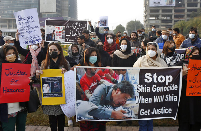 Members of a civil society organization hold a demonstration to protest the killing of coal mine workers by gunmen near the Machh coal field, in Lahore, Pakistan, Thursday, Jan. 7, 2021. Pakistan's minority Shiites continued their sit-in for a fifth straight day insisting they will bury their dead only when Prime Minister Imran Khan personally visits them to assure protection. (AP Photo/K.M. Chaudary)