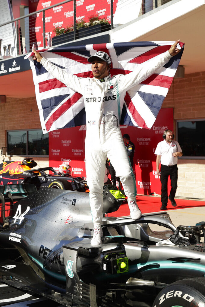 Mercedes driver Lewis Hamilton, of Britain, celebrates after the Formula One U.S. Grand Prix auto race at the Circuit of the Americas, Sunday, Nov. 3, 2019, in Austin, Texas. (AP Photo/Eric Gay)