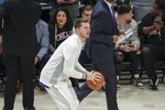 Luka Doncic of the Dallas Mavericks warms up before the NBA All-Star basketball game Sunday, Feb. 16, 2020, in Chicago. (AP Photo/David Banks)