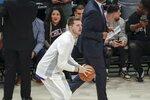 Luka Doncic of the Dallas Mavericks warms up before the NBA All-Star basketball game Sunday, Feb. 16, 2020, in Chicago. (AP Photo/David Banks)