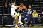 Oral Roberts forward Elijah Lufile drives around Iowa forward Cordell Pemsl, left, during the first half of an NCAA college basketball game, Friday, Nov. 15, 2019, in Iowa City, Iowa.(AP Photo/Charlie Neibergall)