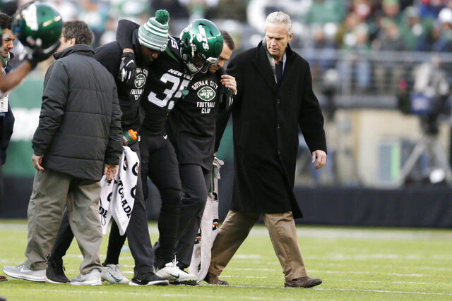 "FILE - In this Dec. 8, 2019, file photo, New York Jets cornerback Kyron Brown (35) is helped off the field after being injured during the second half of an NFL football game against the Miami Dolphins in East Rutherford, N.J. The New York Jets finished the season with a league-high 20 players on injured reserve and had so many other injuries the organization is studying every step from practice to recovery down to how they care for injuries to stay healthier in the future. Jets general manager Joe Douglas hopes 2019 was a ""bit of anomaly."" (AP Photo/Adam Hunger, File)"