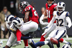Los Angeles Rams cornerback Jalen Ramsey (20) hits Atlanta Falcons running back Devonta Freeman (24) causing a fumble during the first half of an NFL football game, Sunday, Oct. 20, 2019, in Atlanta. (AP Photo/John Bazemore)