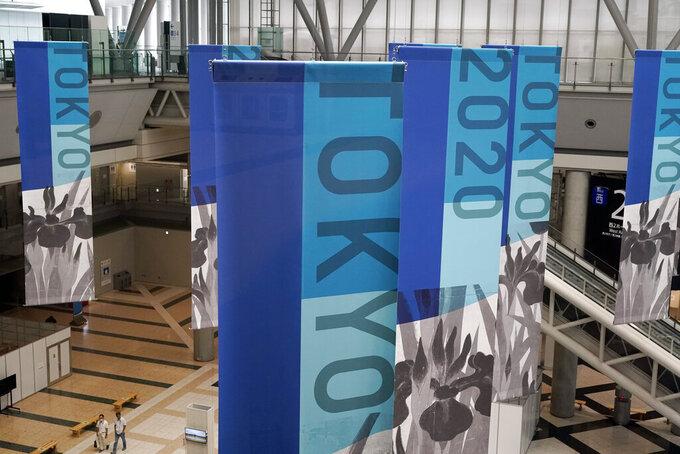 Banners are hung at Main Press Center (MPC) for Tokyo 2020 Olympic Games at Tokyo Big Site Friday, July 2, 2021, in Tokyo. (AP Photo/Shuji Kajiyama)