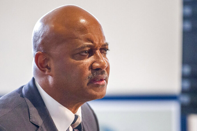 FILE - In this Oct. 3, 2019 file photo, Indiana Attorney General Curtis Hill holds a press conference in South Bend, Ind. Lawyers for Indiana Attorney General Curtis Hill are trying to block two women from testifying about previous sexual misconduct allegations as he faces claims that he drunkenly groped four women at a bar last year. The state's attorney disciplinary commission wants the women to testify about Hill's actions when he was the Elkhart County prosecutor before becoming attorney general in 2017.  (Robert Franklin/South Bend Tribune via AP File)