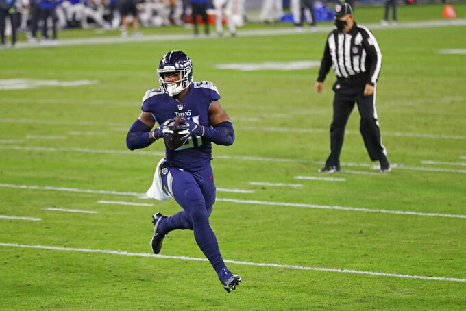 Tennessee Titans tight end Jonnu Smith scores a touchdown against the Indianapolis Colts in the first half of an NFL football game Thursday, Nov. 12, 2020, in Nashville, Tenn. (AP Photo/Wade Payne)