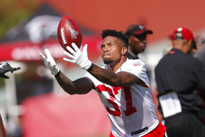Atlanta Falcons free safety Ricardo Allen (37) tosses a ball in the air during their NFL training camp football practice Thursday, July 25, 2019, in Flowery Branch, Ga.(AP Photo/John Bazemore)