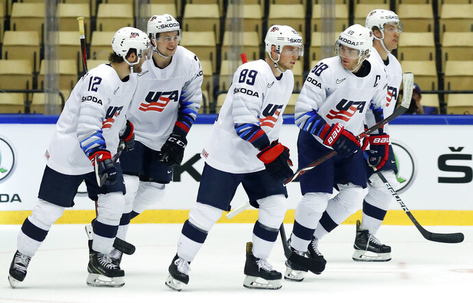 Patrick Kane, 2nd right, of the United States celebrates with teammates after scoring his sides second goal during the Ice Hockey World Championships group B match between Norway and the United States at the Jyske Bank Boxen arena in Herning, Denmark, Sunday, May 13, 2018. (AP Photo/Petr David Josek)