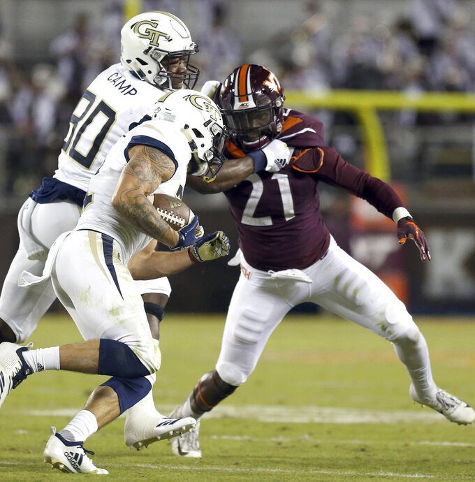 Georgia Tech's Jalen Camp (80) blocks for running back Nathan Cottrell (31) past Virginia Tech's Reggie Ford (21) in the first half of an NCAA college football game, Thursday, Oct. 25 2018, in Blacksburg Va. (Matt Gentry/The Roanoke Times via AP)