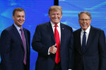 FILE - In this Friday, April 26, 2019 file photo, President Donald Trump poses with NRA-ILA Executive Director Chris Cox, left, and executive Vice President Wayne LaPierre before speaking at the National Rifle Association Institute for Legislative Action Leadership Forum in Lucas Oil Stadium in Indianapolis. The National Rifle Association is meeting in the shadows of Congress as its leaders remain under fire for spending and its operations. Amid the turmoil, lawmakers are considering steps to stem gun violence, including proposals long opposed by the NRA. (AP Photo/Michael Conroy, File)