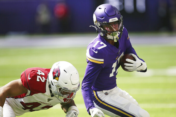 Minnesota Vikings wide receiver Dillon Mitchell (17) runs from Arizona Cardinals safety Jonathan Owens after making a reception during the second half of an NFL preseason football game, Saturday, Aug. 24, 2019, in Minneapolis. (AP Photo/Jim Mone)