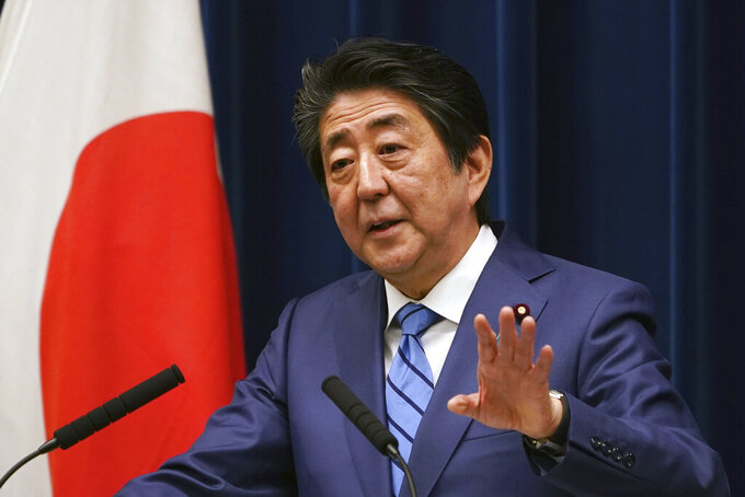 Japanese Prime Minister Shinzo Abe answers a question during his press conference about the coronavirus situation in Japan, at the Prime Minister's office in Tokyo Saturday, March 14, 2020. (AP Photo/Eugene Hoshiko)