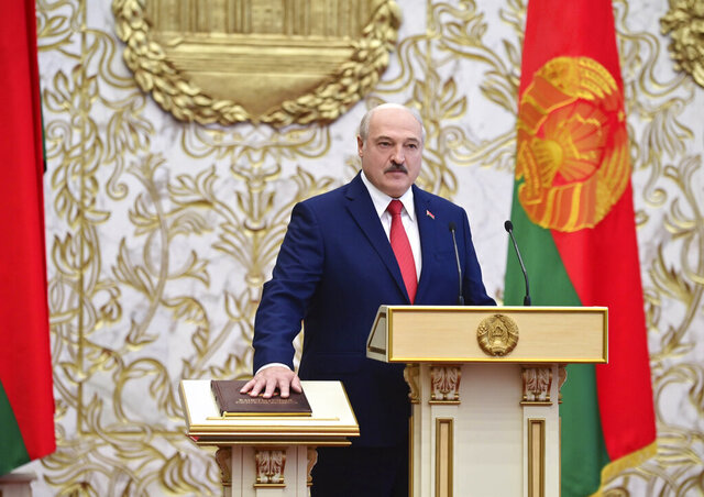 Belarusian President Alexander Lukashenko takes his oath of office during his inauguration ceremony at the Palace of the Independence in Minsk, Belarus, Wednesday, Sept. 23, 2020. Lukashenko of Belarus has assumed his sixth term of office in an inauguration ceremony that wasn't announced in advance. State news agency BelTA reports that the ceremony will take place with several hundred top government official present. (Andrei Stasevich/Pool Photo via AP)