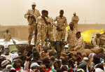 Sudanese soldiers from the Rapid Support Forces unit which led by Gen. Mohammed Hamdan Dagalo, the deputy head of the military council, better known as Hemedti, stand on their vehicle during a military-backed rally, in Mayo district, south of Khartoum, Sudan, Saturday, June 29, 2019. Sudan's ruling generals say they have accepted a joint proposal from the African Union and Ethiopia to work toward a transitional government. (AP Photo/Hussein Malla)