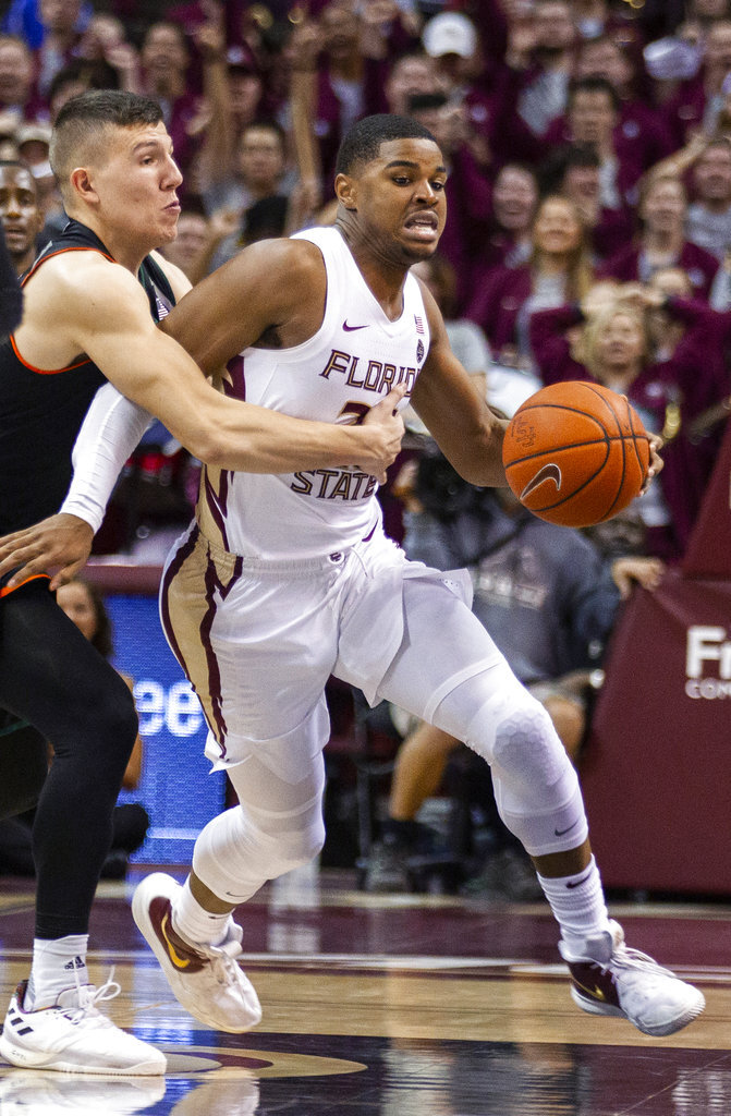 Miami guard Dejan Vasiljevic fouls Florida State guard M.J. Walker late in the second half of an NCAA college basketball game in Tallahassee, Fla., Wednesday, Jan. 9, 2019. Florida State won 68-62. (AP Photo/Mark Wallheiser)