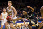 Notre Dame's Dane Goodwin (23) drives in as Wake Forest's Brandon Childress (0) defends during the second half of an NCAA college basketball game Wednesday, Jan. 29, 2020, in South Bend, Ind. Notre Dame won 90-80. (AP Photo/Robert Franklin)