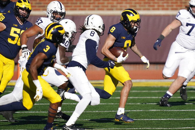 Michigan wide receiver Ronnie Bell (8) breaks through the Penn State defense during the first half of an NCAA college football game, Saturday, Nov. 28, 2020, in Ann Arbor, Mich. (AP Photo/Carlos Osorio)