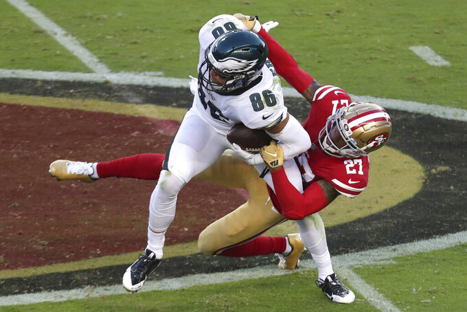 Philadelphia Eagles tight end Zach Ertz (86) is grabbed by San Francisco 49ers cornerback Dontae Johnson (27) during the first half of an NFL football game in Santa Clara, Calif., Sunday, Oct. 4, 2020. (AP Photo/Jed Jacobsohn)