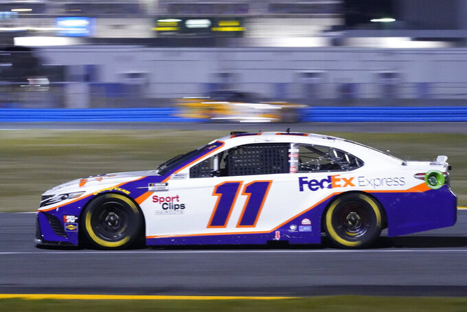 Denny Hamlin (11) navigates the infield course as he leads in the early laps of the NASCAR Clash auto race at Daytona International Speedway, Tuesday, Feb. 9, 2021, in Daytona Beach, Fla. (AP Photo/John Raoux)