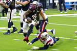Houston Texans quarterback Deshaun Watson (4) leaps from the grasp of New England Patriots defensive end Tashawn Bower (96) during the first half of an NFL football game, Sunday, Nov. 22, 2020, in Houston. (AP Photo/David J. Phillip)