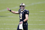 New Orleans Saints quarterback Drew Brees (9) calls out to go for a two-point conversion after throwing a touchdown pass in the second half of an NFL football game against the Kansas City Chiefs in New Orleans, Sunday, Dec. 20, 2020. (AP Photo/Brett Duke)