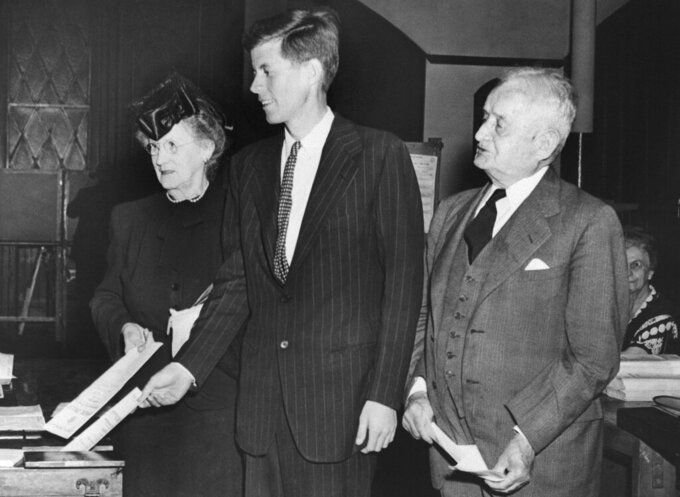 "FILE - In this June 18, 1946, file photo, Democrat congressional candidate John F. Kennedy, center, casts his vote beside his grandparents Mary Josephine ""Josie"" Fitzgerald, left, and former Boston Mayor John F. ""Honey Fitz"" Fitzgerald, during a primary election in Boston. Fitzgerald served two terms as Boston's mayor in the early 1900s. (AP Photo, File)"