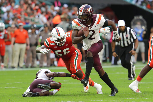 FILE - In this Saturday, Oct. 5, 2019, file photo, Virginia Tech quarterback Hendon Hooker (2) runs as Miami linebacker Michael Pinckney (56) defends during the first half of an NCAA college football game in Miami Gardens, Fla. Virginia Tech plays North Carolina State on Saturday, Sept. 26. (AP Photo/Lynne Sladky)