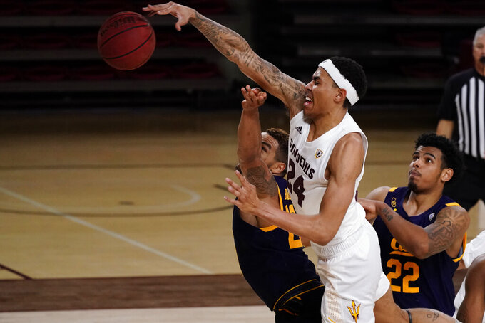 Arizona State forward Jalen Graham (24) blocks the shot of California guard Matt Bradley (20) during the second half of an NCAA college basketball game Thursday, Jan. 28, 2021, in Tempe, Ariz. Arizona State won 72-68. (AP Photo/Rick Scuteri)